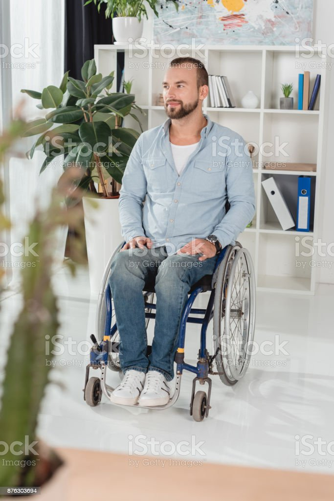 disabled man on wheelchair stock photo