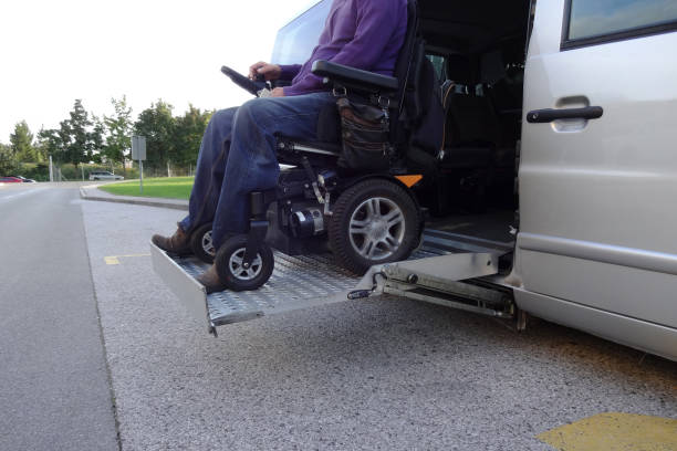 Disabled Man on Wheelchair using vehicle stock photo