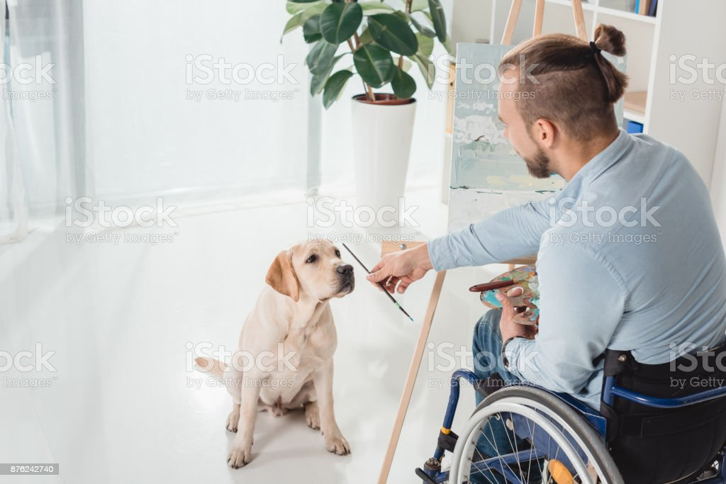 disabled man painting stock photo