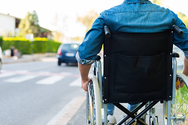 Disabled man preparing to go across the road stock photo