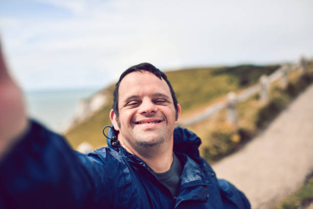 Disabled Man Taking A Selfie stock photo