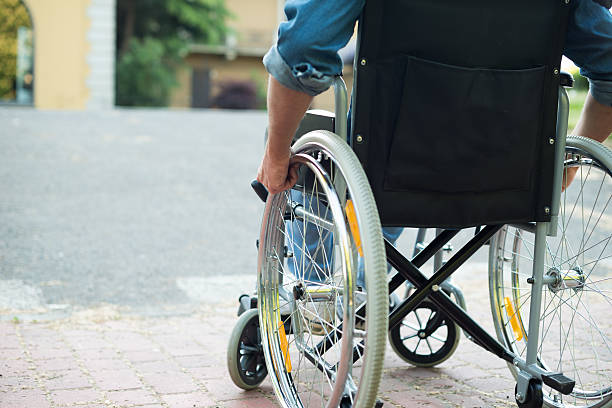 Disabled man trying to getting on a ramp stock photo