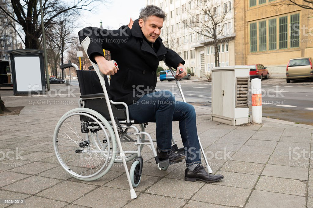 Disabled Man Trying To Walk stock photo