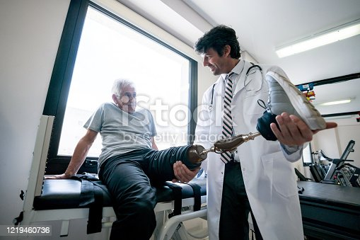 istock Disabled man using a prosthetic and doing physiotherapy 1219460736