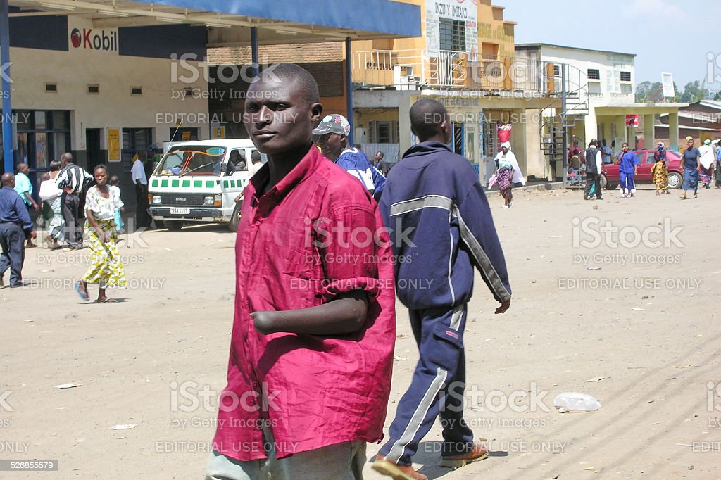 Disabled man walks on the street in Gisenyi, Rwanda. stock photo