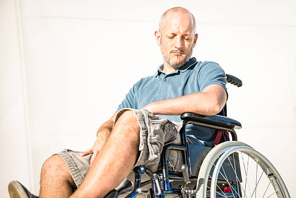 Disabled man with handicap on wheelchair in depression moment - foto de stock