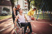 istock Disabled men playing basketball with friends 1278613889