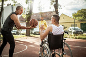 istock Disabled men playing basketball with friends 1278613939