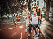 istock Disabled men playing basketball with friends 1278613940