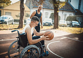 istock Disabled men playing basketball with friends 1278614075