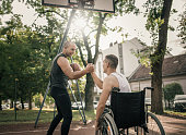 istock Disabled men playing basketball with friends 1278614993