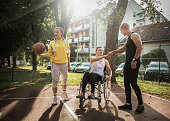 istock Disabled men playing basketball with friends 1278615322
