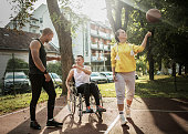 istock Disabled men playing basketball with friends 1278615441