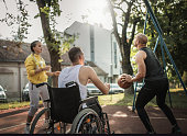 istock Disabled men playing basketball with friends 1278615768