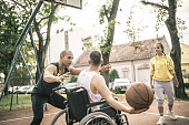 istock Disabled men playing basketball with friends 1278616557