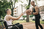 istock Disabled men playing basketball with friends 1278616725