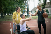 istock Disabled men playing basketball with friends 1278617061