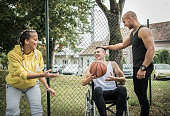 istock Disabled men playing basketball with friends 1278618737