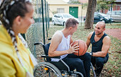 istock Disabled men playing basketball with friends 1278619050