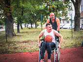 istock Disabled men playing basketball with friends 1278619583