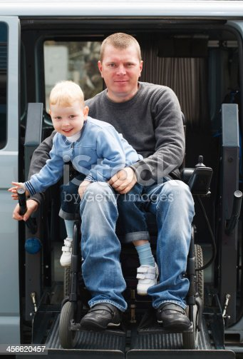 466456685 istock photo Disabled Men with son on Wheelchair Lift 456620457