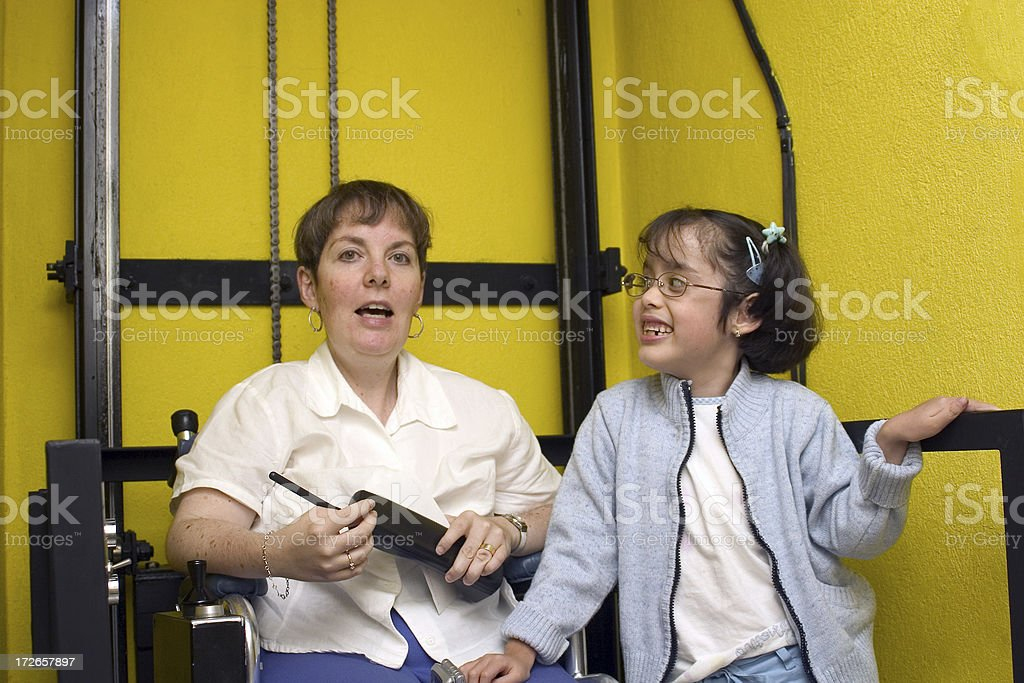 disabled mother in everyday activities royalty-free stock photo