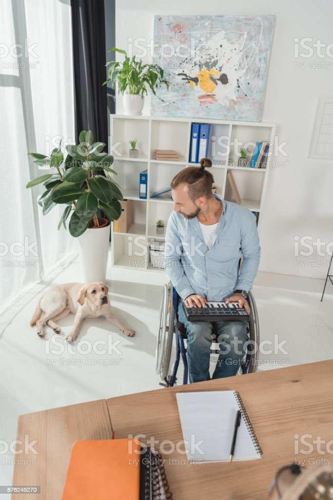 disabled musician working with mpc pad stock photo