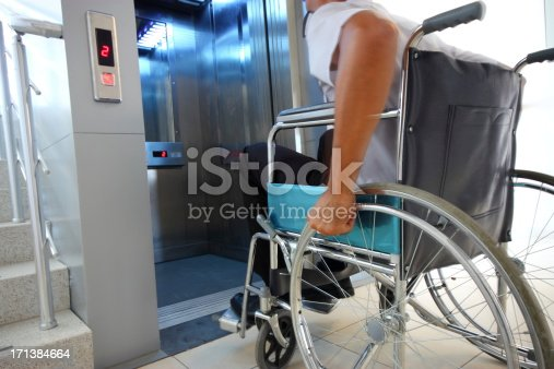 istock A disabled person entering an elevator 171384664