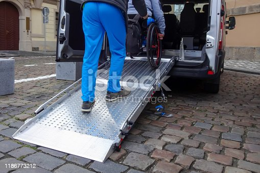 466456685 istock photo Disabled person on wheelchair using car lift 1186773212