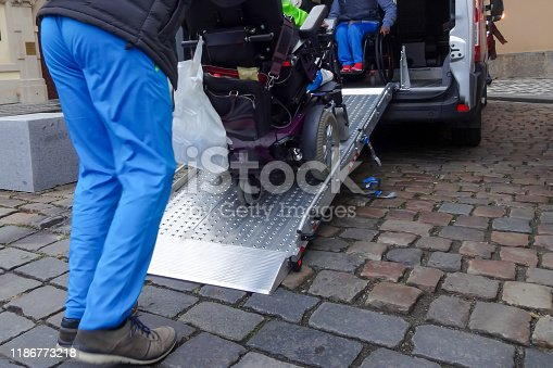 466456685 istock photo Disabled person on wheelchair using car lift 1186773218