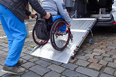 istock Disabled person on wheelchair using car lift 1186773260