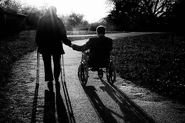 Disabled Senior Couple Walking Along Path, Black and White stock photo