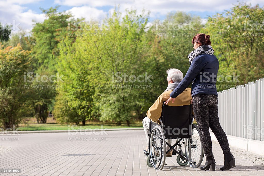 Disabled senior in the park stock photo