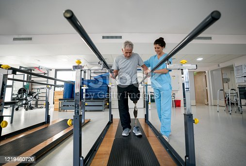 istock Disabled senior man wearing a prosthetic and doing physical therapy 1219460726