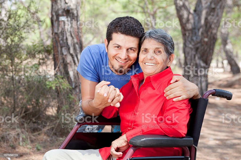 Disabled senior with her son stock photo