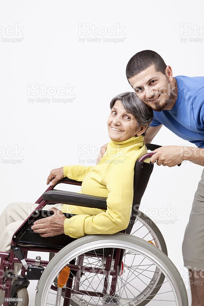 Disabled senior with her son royalty-free stock photo