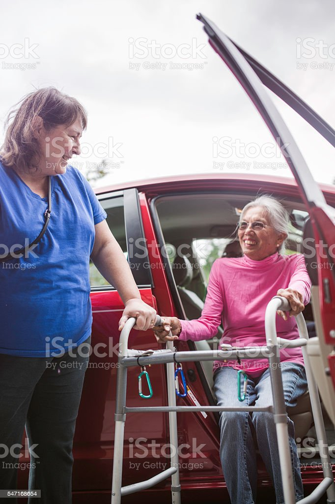 Disabled Senior Woman Getting A Ride Stock Photo & More Pictures of ...