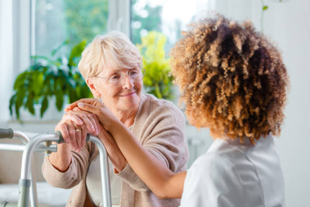 Disabled senior woman with a nurse stock photo