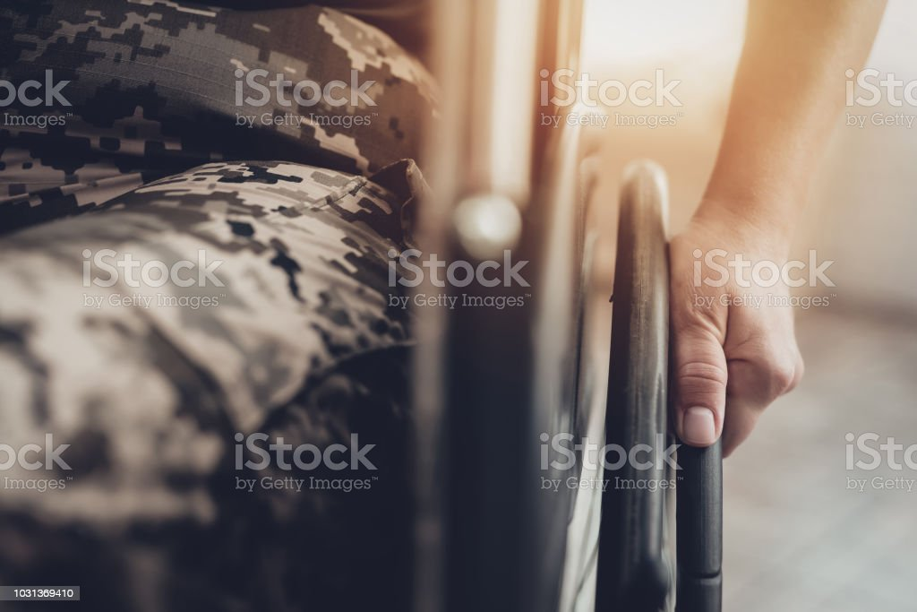 Disabled Soldier In A Wheelchair. Paralyzed Woman. stock photo