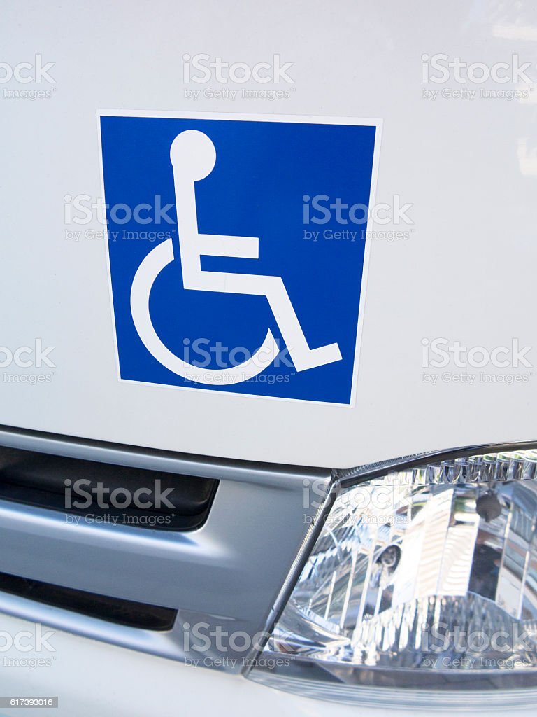 Disabled sticker on a car stock photo