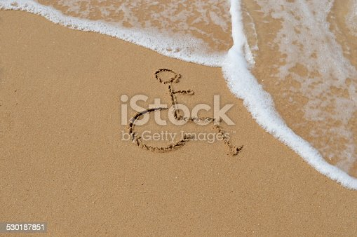 Symbol for disabled is drawn in the sand at the beach