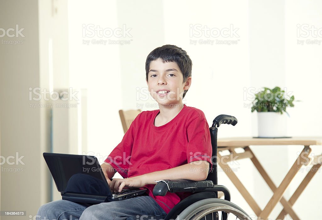 Disabled Teen Using Computer stock photo