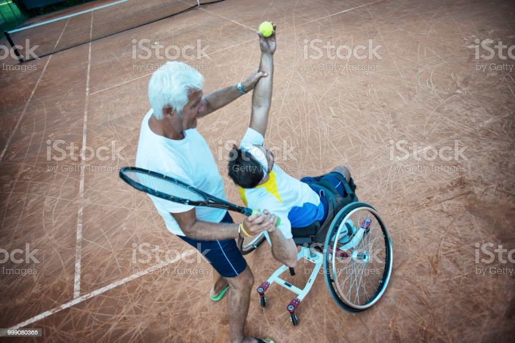 Disabled Tennis Player and his Coach stock photo