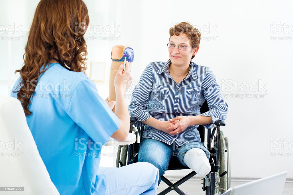 Disabled Woman At Doctors Office. stock photo