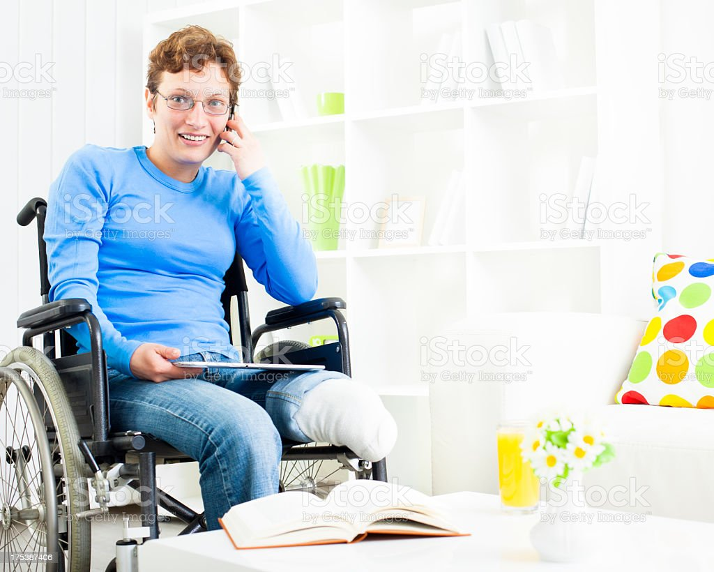 Disabled Woman in wheelchair talking on the phone. royalty-free stock photo
