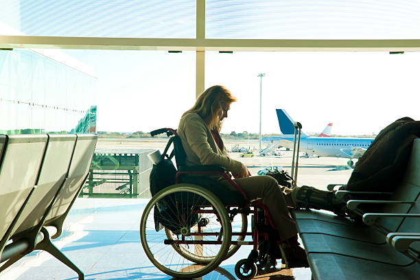 Disabled woman stranded at the airport stock photo