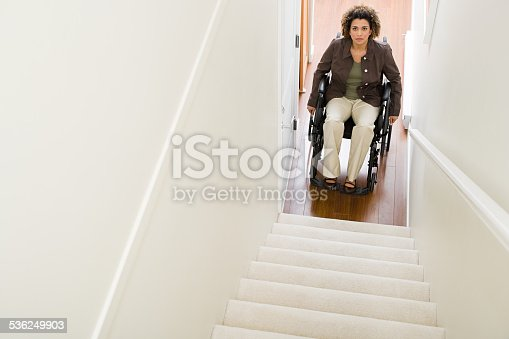 istock Disabled woman trapped at bottom of stairs 536249903