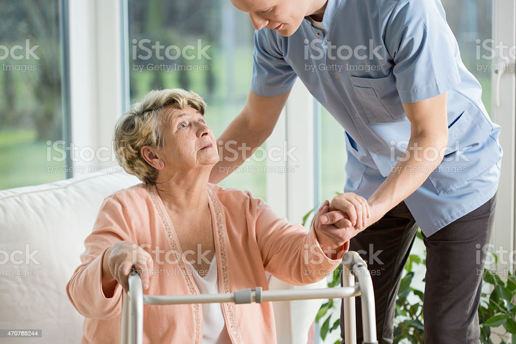 Disabled woman using walker stock photo