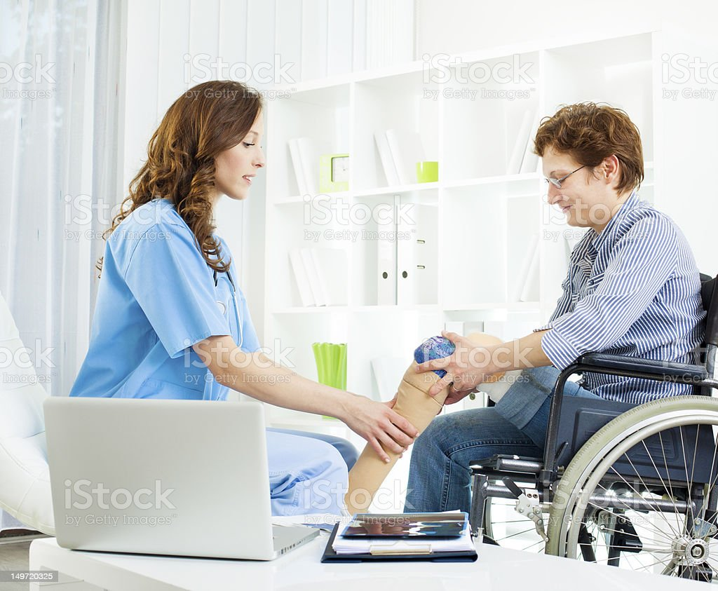 Disabled Woman With Artificial Leg At Doctors Office. stock photo