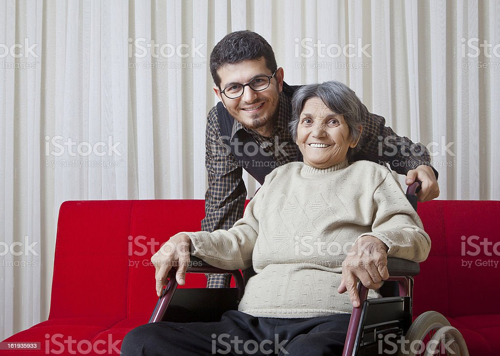 Disabled woman with his son stock photo